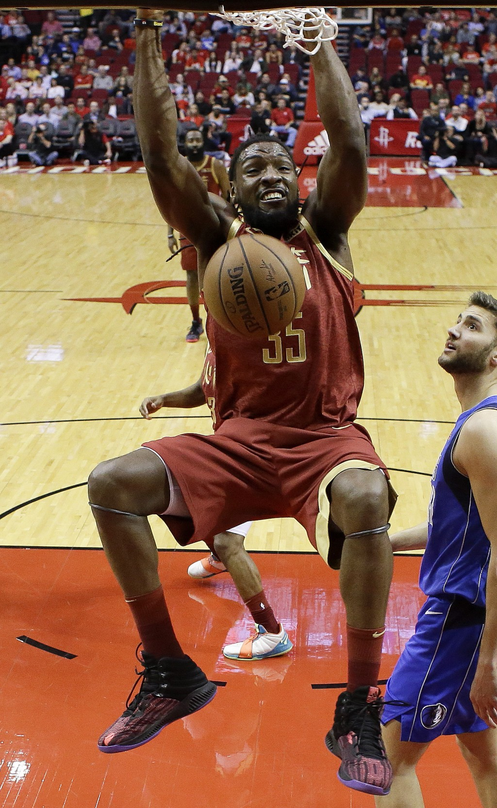 Houston Rockets forward Kenneth Faried dunks during the first half of an NBA basketball game against the Dallas Mavericks, Monday, Feb. 11, 2019, in H...