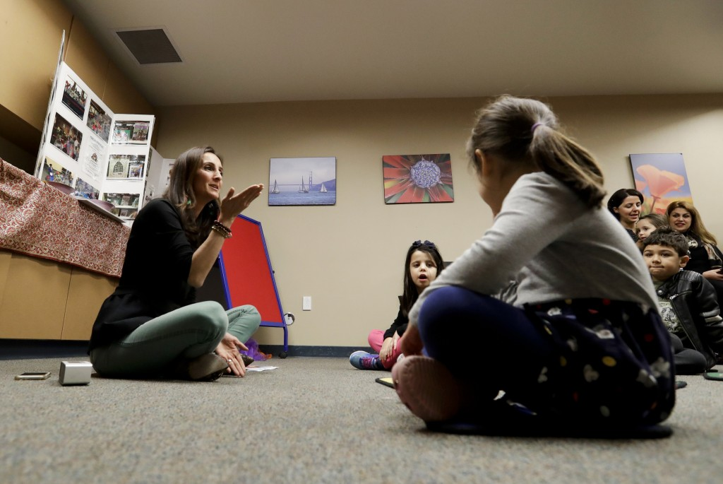 In this Jan. 23, 2019, photo, Bahareh Hedyahe leads Persian story time at Irvine public library in Irvine, Calif. It's been four decades since the Ira...