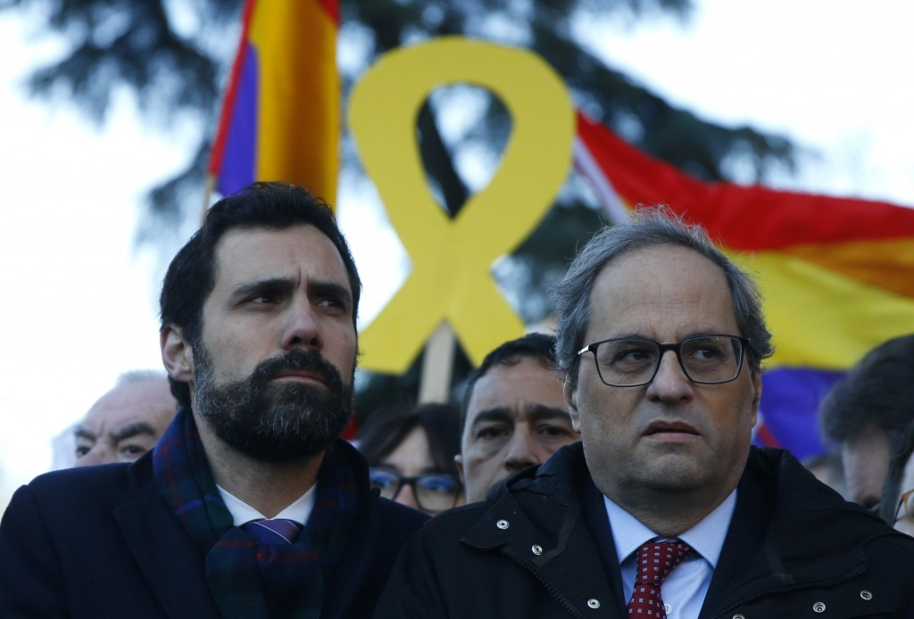 Catalan regional President Quim Torra, right, and the president of Catalonian Parliament Roger Torrent arrive at the Spanish Supreme Court in Madrid,