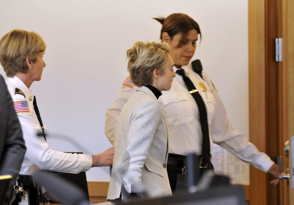 Michelle Carter, 22, center,  is led away by court officers after a hearing on her prison sentence in Taunton District Court in Taunton, Mass. Monday,...