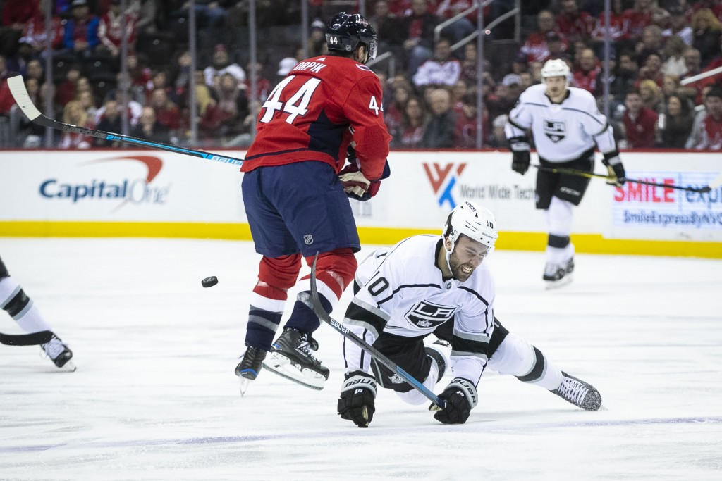 Los Angeles Kings center Michael Amadio (10) falls as Washington Capitals defenseman Brooks Orpik (44) moves the puck during the first period of an NH...