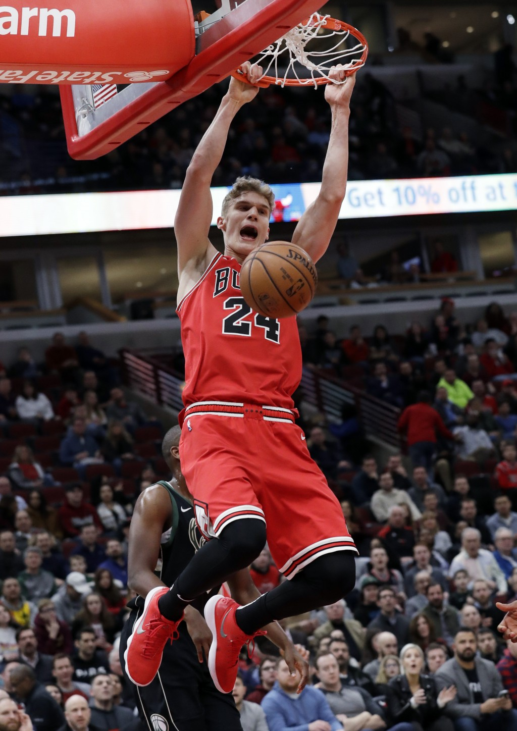 Chicago Bulls forward Lauri Markkanen reacts as he dunks against the Milwaukee Bucks during the first half of an NBA basketball game Monday, Feb. 11, ...