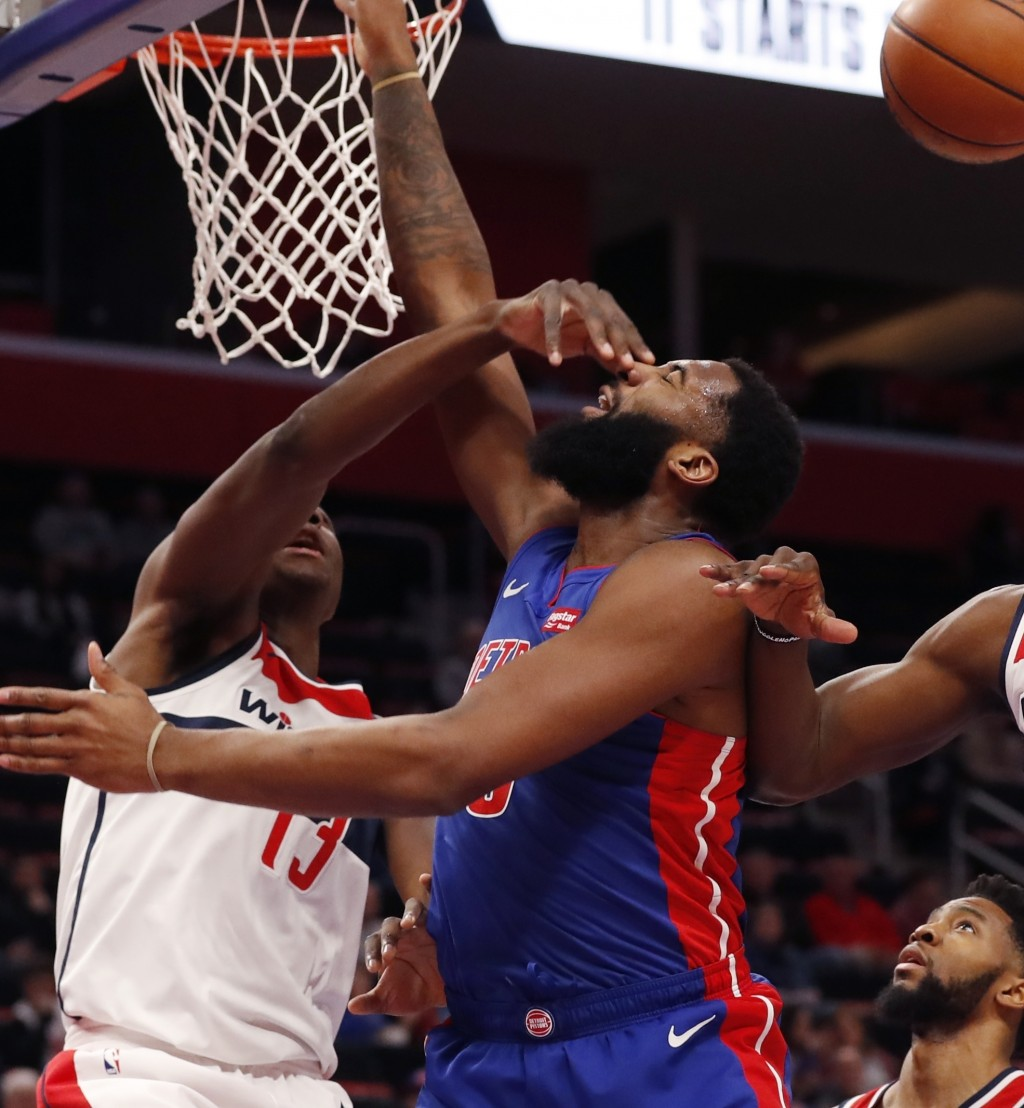 Washington Wizards center Thomas Bryant (13) fouls Detroit Pistons center Andre Drummond (0) during the first half of an NBA basketball game, Monday, ...