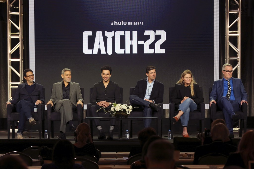 "Grant Heslov, from left, George Clooney, Christopher Abbott, Kyle Chandler, Ellen Kuras and Luke Davies participate in the ""Catch-22"" panel during the..."