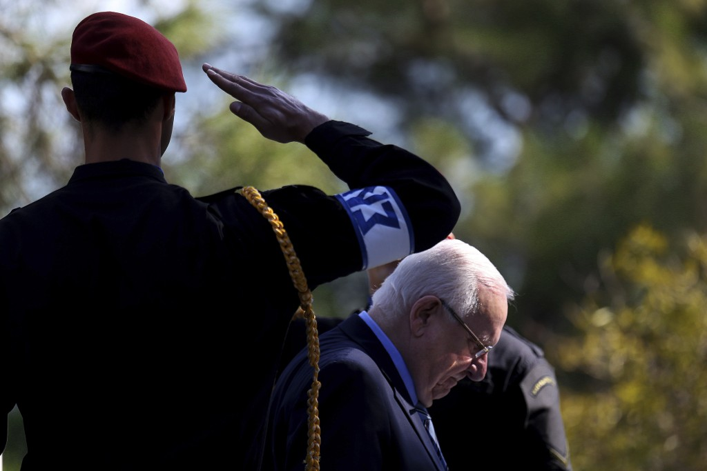 Israel's President Reuven Rivlin reviews a military guard of honor during a welcoming ceremony before a meeting with Cyprus' president Nicos Anastasia