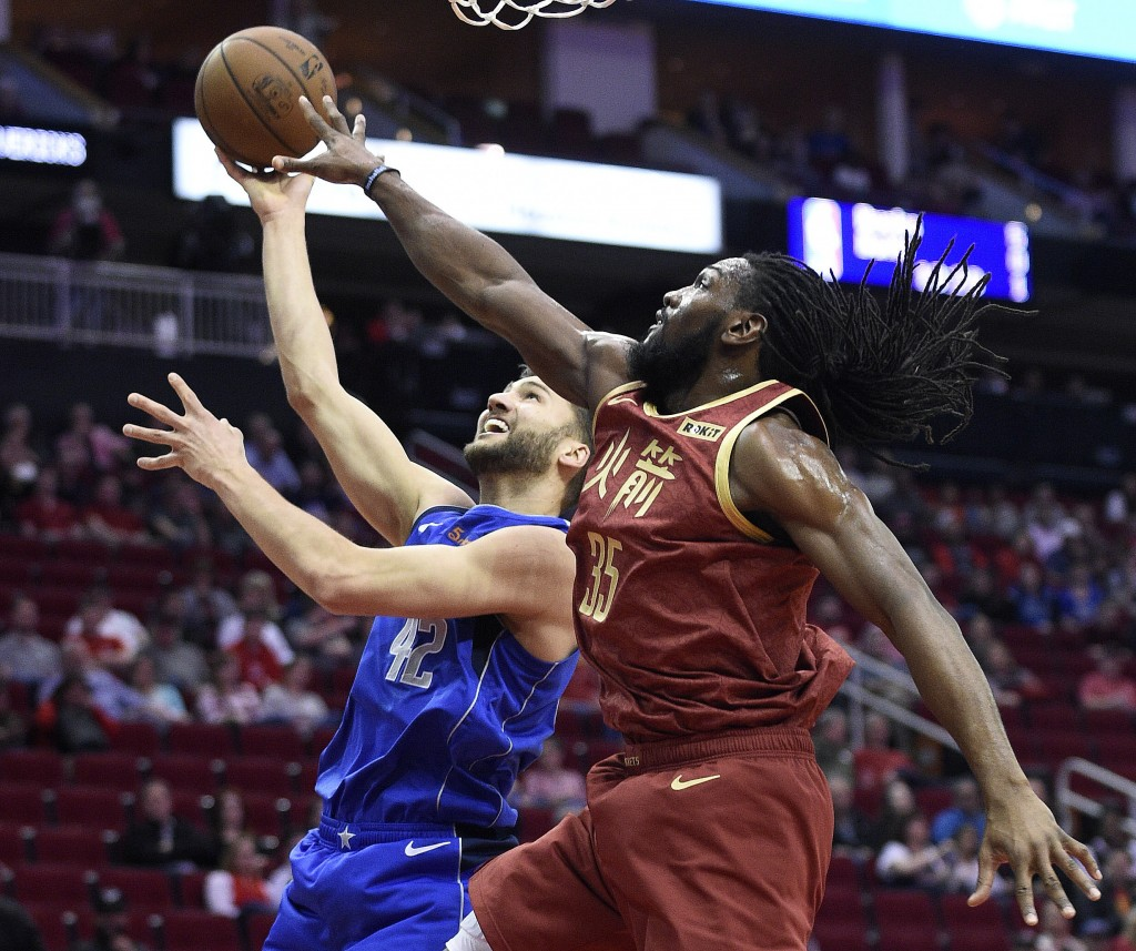 Dallas Mavericks forward Maximilian Kleber, left, shorts as Houston Rockets forward Kenneth Faried defends during the first half of an NBA basketball