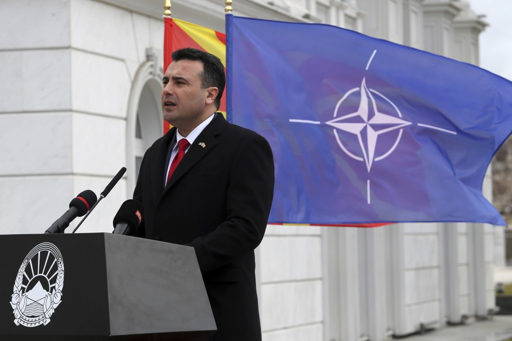 Macedonian Prime Minister Zoran Zaev delivers a speech in front of the NATO flag during a ceremony at the government building in Skopje, Tuesday, Feb.