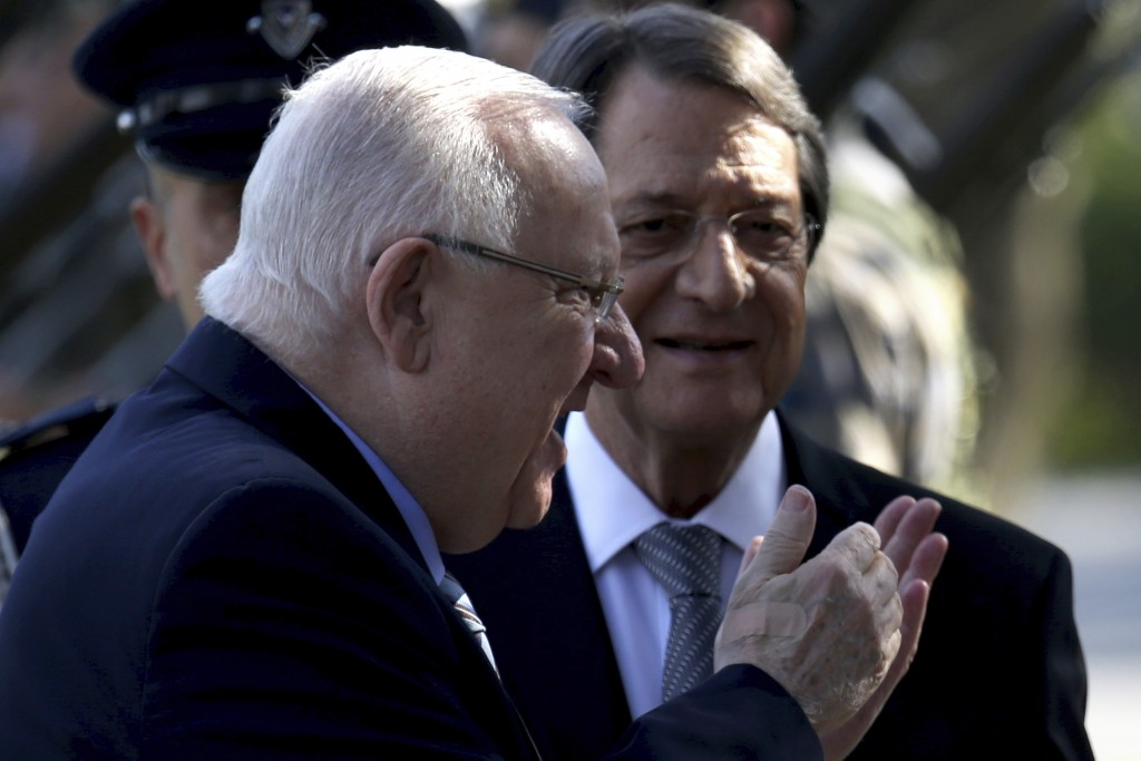 Cyprus' president Nicos Anastasiades, right, and Israel's President Reuven Rivlin review a military guard of honor during a welcoming ceremony at the ...