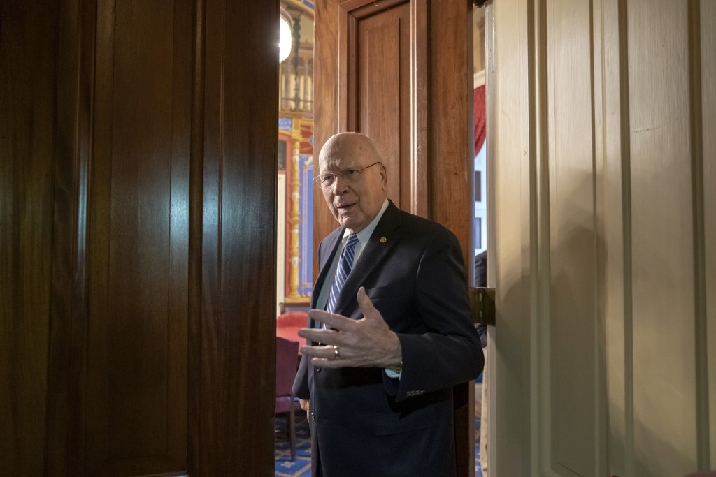 Sen. Patrick Leahy, D-Vt., the ranking member of the Senate Appropriations Committee, enters a closed meeting room at the Capitol as bipartisan House ...