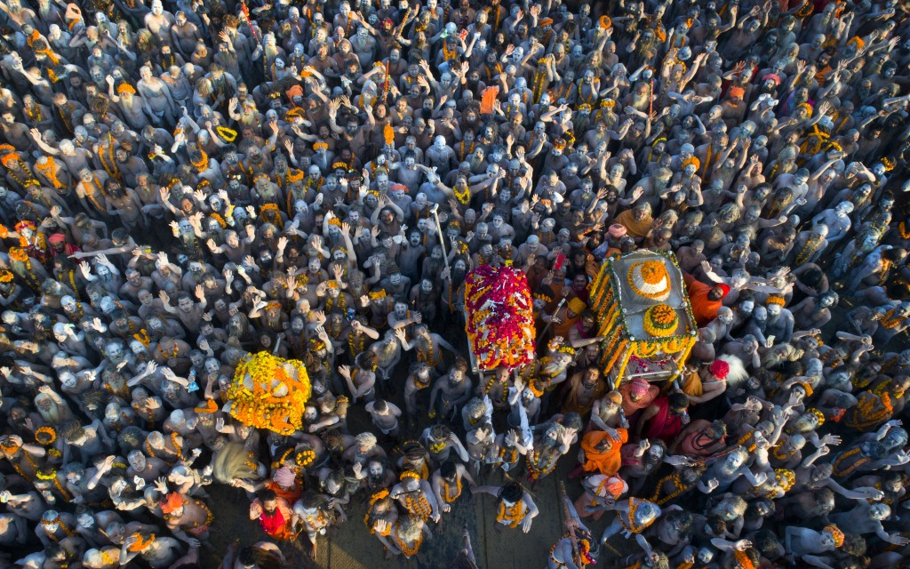 In this Feb. 10, 2019, file photo, Naga Sadhus or naked holy men arrive in a procession for a dip at Sangam, the confluence of three holy rivers durin...