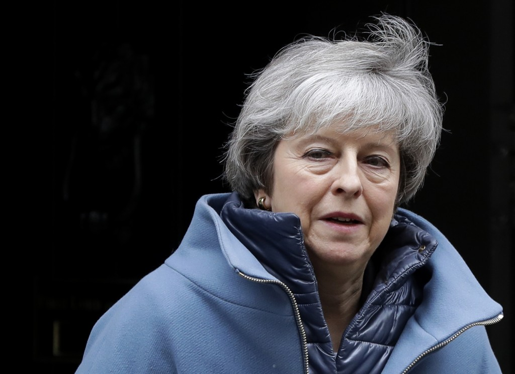 Britain's Prime Minister Theresa May leaves 10 Downing Street in London, Tuesday, Feb. 12, 2019. May is expected to address Parliament on Brexit later