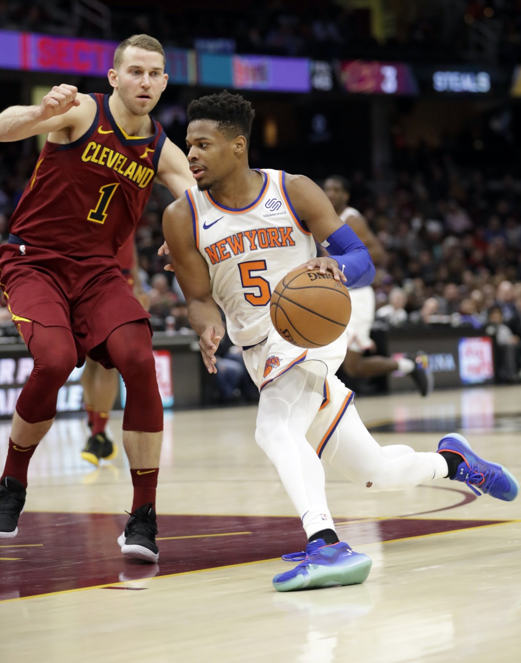 New York Knicks' Dennis Smith Jr. (5) drives past Cleveland Cavaliers' Nik Stauskas (1) in the second half of an NBA basketball game, Monday, Feb. 11,