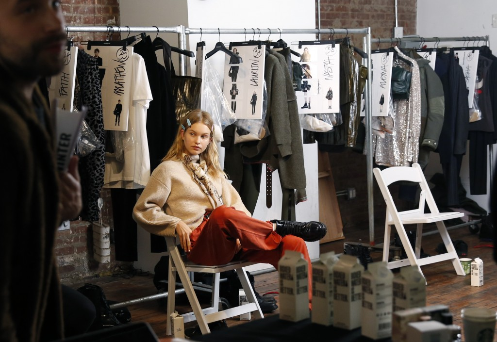 A model waits backstage for first looks before the Zadig & Voltaire show is modeled during Fashion Week, Monday, Feb. 11, 2019, in New York. (AP Photo