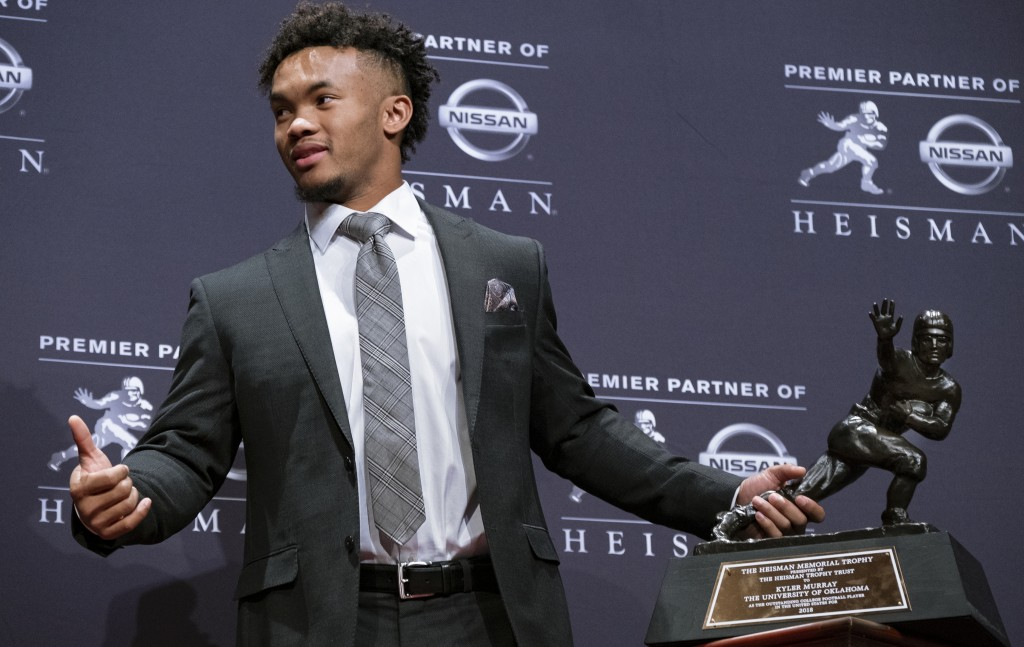 FILE - In this Dec. 8, 2018, file photo, Oklahoma quarterback Kyler Murray holds the Hesiman Trophy after winning the award in New York. Murray's lock...