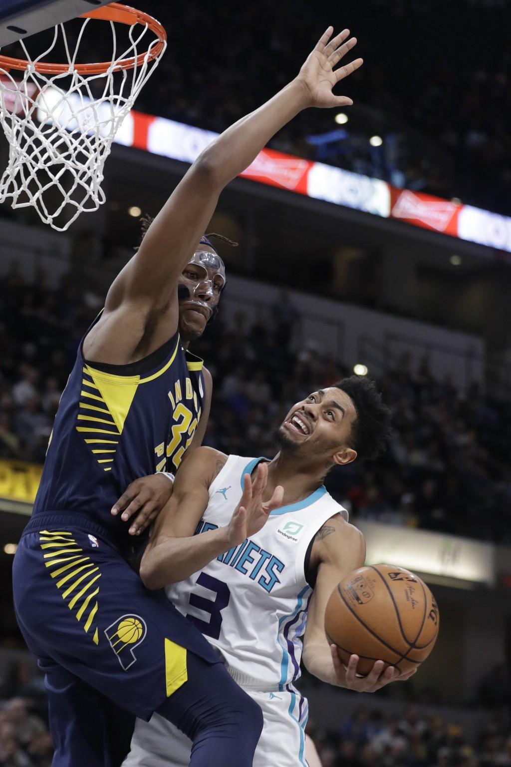 Charlotte Hornets' Jeremy Lamb (3) puts up a shot against Indiana Pacers' Myles Turner during the first half of an NBA basketball game, Monday, Feb. 1...