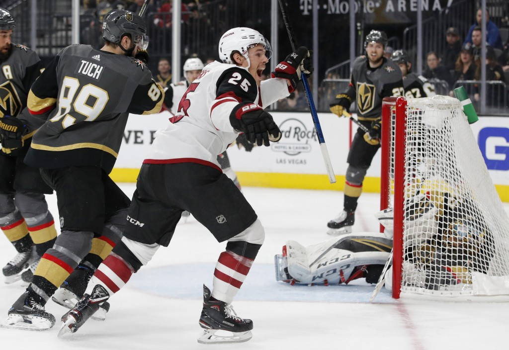 Arizona Coyotes center Nick Cousins (25) celebrates after scoring against the Vegas Golden Knights during the third period of an NHL hockey game Tuesd...