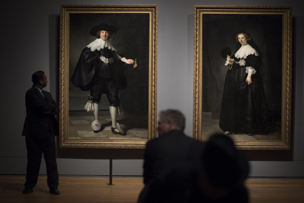 People look at the only two full length portraits Rembrandt ever painted, that of Marten Soolmans, left, and Oopjen Coppit, right, (oil on canvas, 163