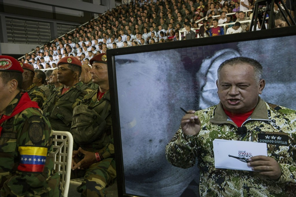 In this Feb. 6, 2019 photo, a screen shows Diosdado Cabello, president of the ruling party-dominated constitutional assembly, during his weekly, live ...