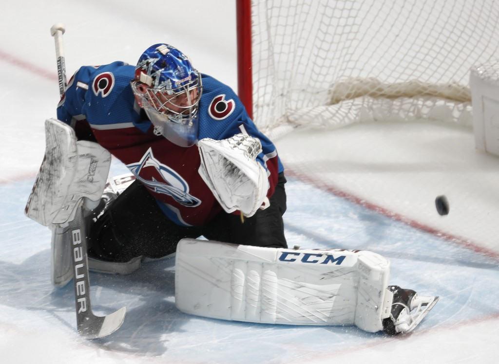 Colorado Avalanche goaltender Semyon Varlamov watches as a shot off the stick of Toronto Maple Leafs right wing Kasperi Kapanen goes into the net for ...