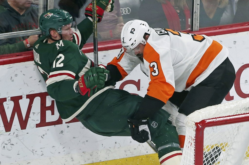 Philadelphia Flyers' Radko Gudas, right, of Czech Republic, checks Minnesota Wild's Eric Staal in the first period of an NHL hockey game, Tuesday, Feb