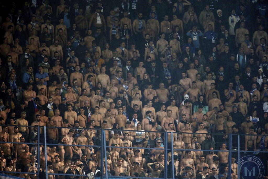 Zenit St. Petersburg fans are seen during the Europa League round of 32 soccer match between Fenerbahce and Zenit, in Istanbul, Tuesday, Feb. 12, 2019...
