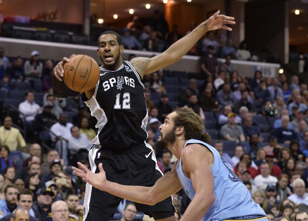 San Antonio Spurs center LaMarcus Aldridge (12) controls the ball in front of Memphis Grizzlies center Joakim Noah during the second half of an NBA ba...