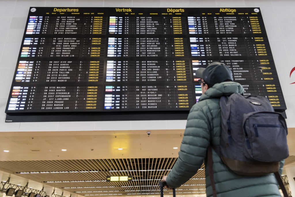 A passenger looks at a departure information screen at Brussels Airport in Zaventem, Wednesday, Feb. 13, 2019. Belgium's air traffic control authority...