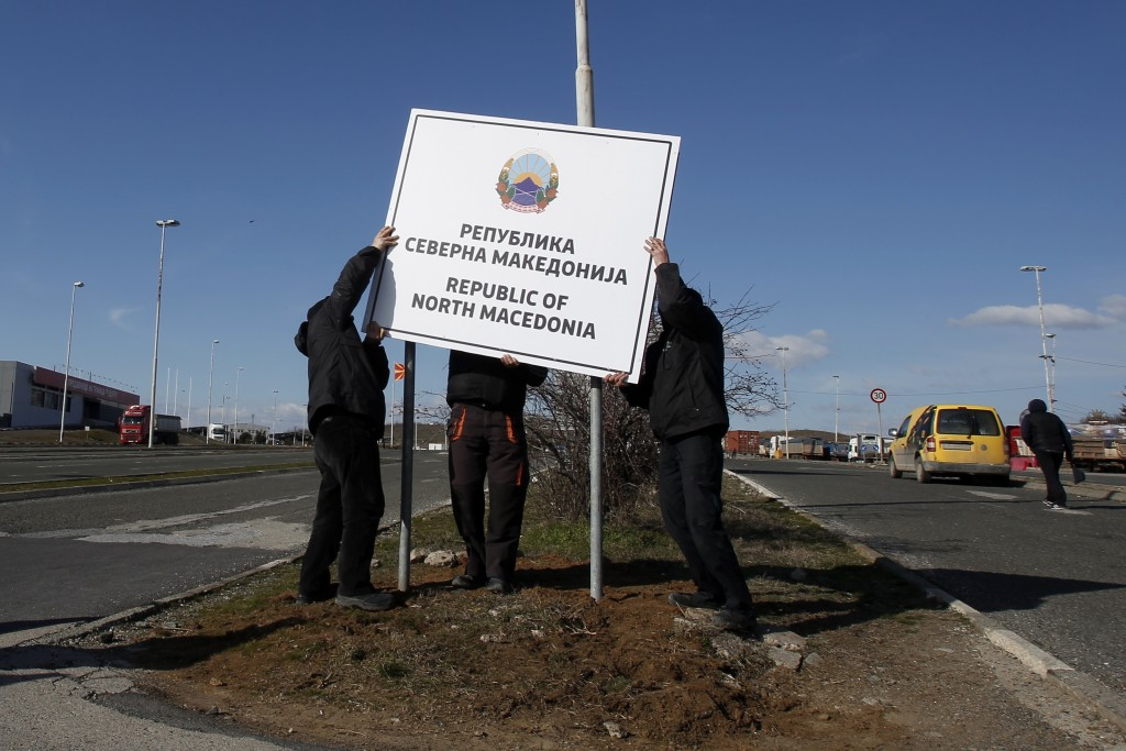 Workers install a new road sign with the name Republic of North Macedonia in the southern border with Greece, near Gevgelija, Wednesday, Feb. 13, 2019...