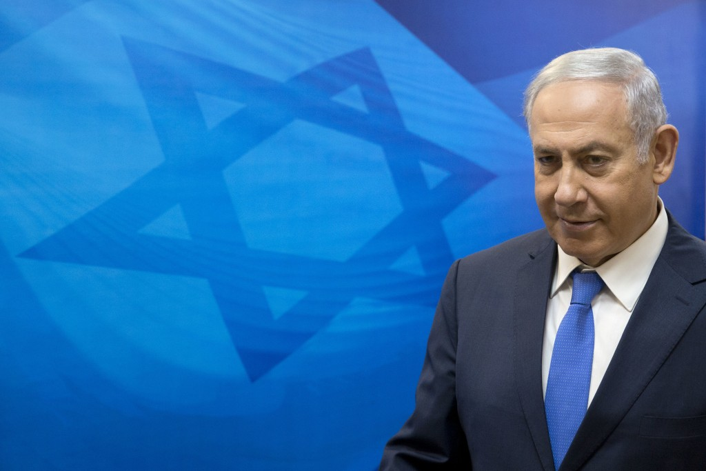 FILE - In this July 29, 2018 file photo, Israeli Prime Minister Benjamin Netanyahu arrives for the weekly cabinet meeting in Jerusalem. A Mideast conf