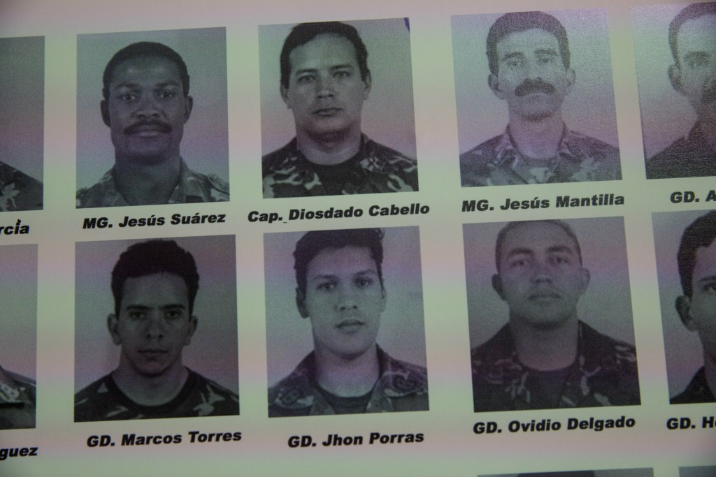 In this Feb. 6, 2019 photo, portraits of soldiers who attacked the presidential palace in a failed 1992 military coup organized by the late Hugo Chave...