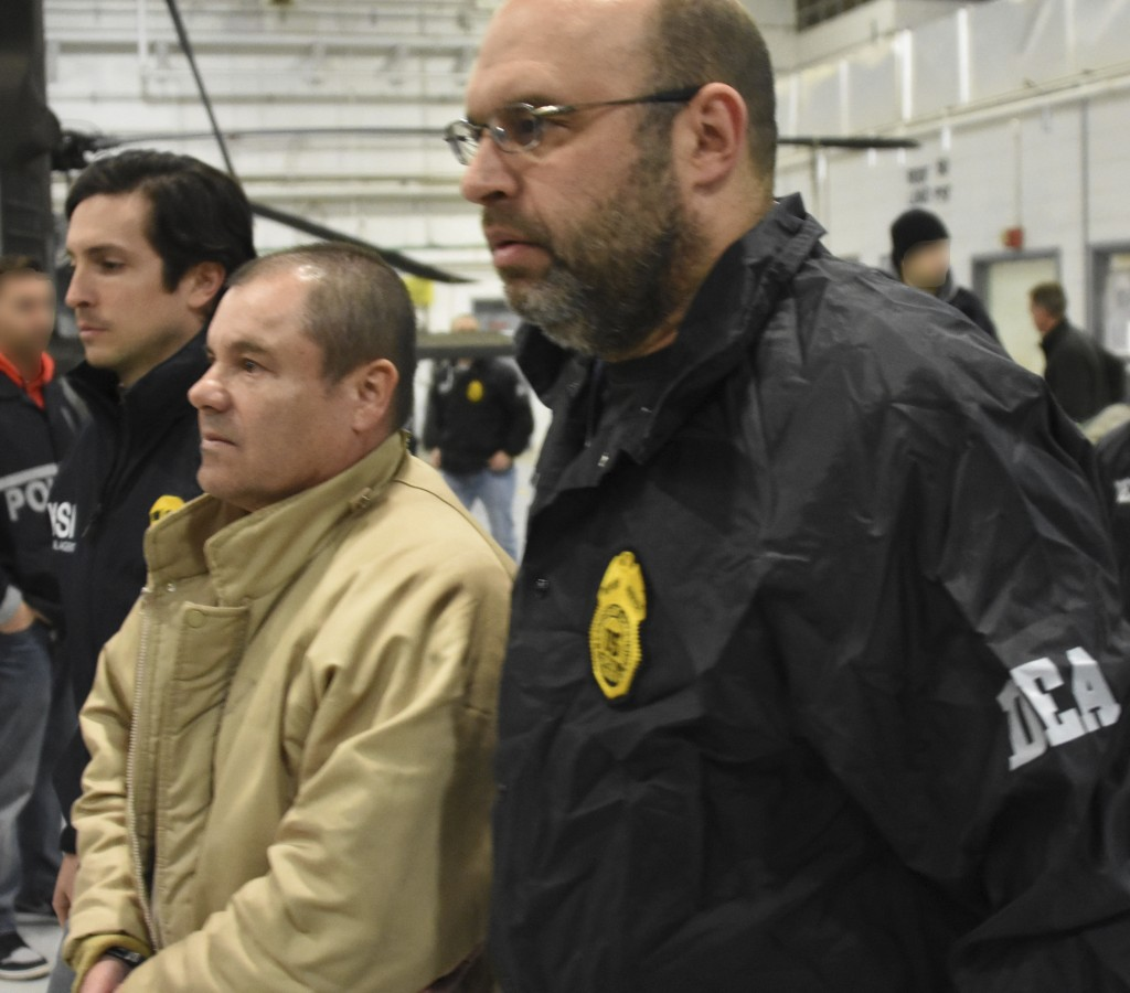 "In this Jan. 19, 2017 photo provided by the United States Drug Enforcement Administration, authorities escort Joaquin ""El Chapo"" Guzman, center, from"