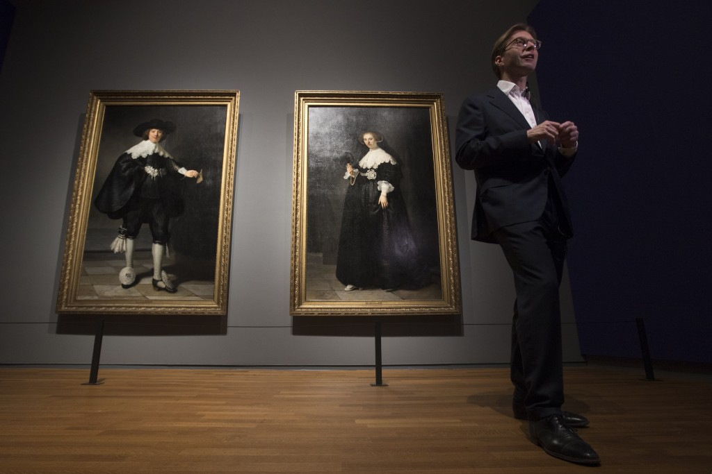 Rijksmuseum director Taco Dibbits is interviewed in front of the only two full length portraits Rembrandt ever painted, that of Marten Soolmans, left,