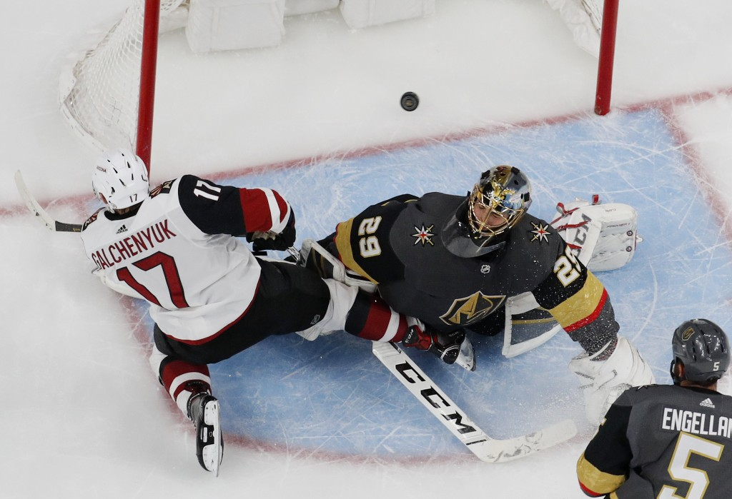 Arizona Coyotes center Alex Galchenyuk (17) scores against Vegas Golden Knights goaltender Marc-Andre Fleury (29) during the second period of an NHL h...