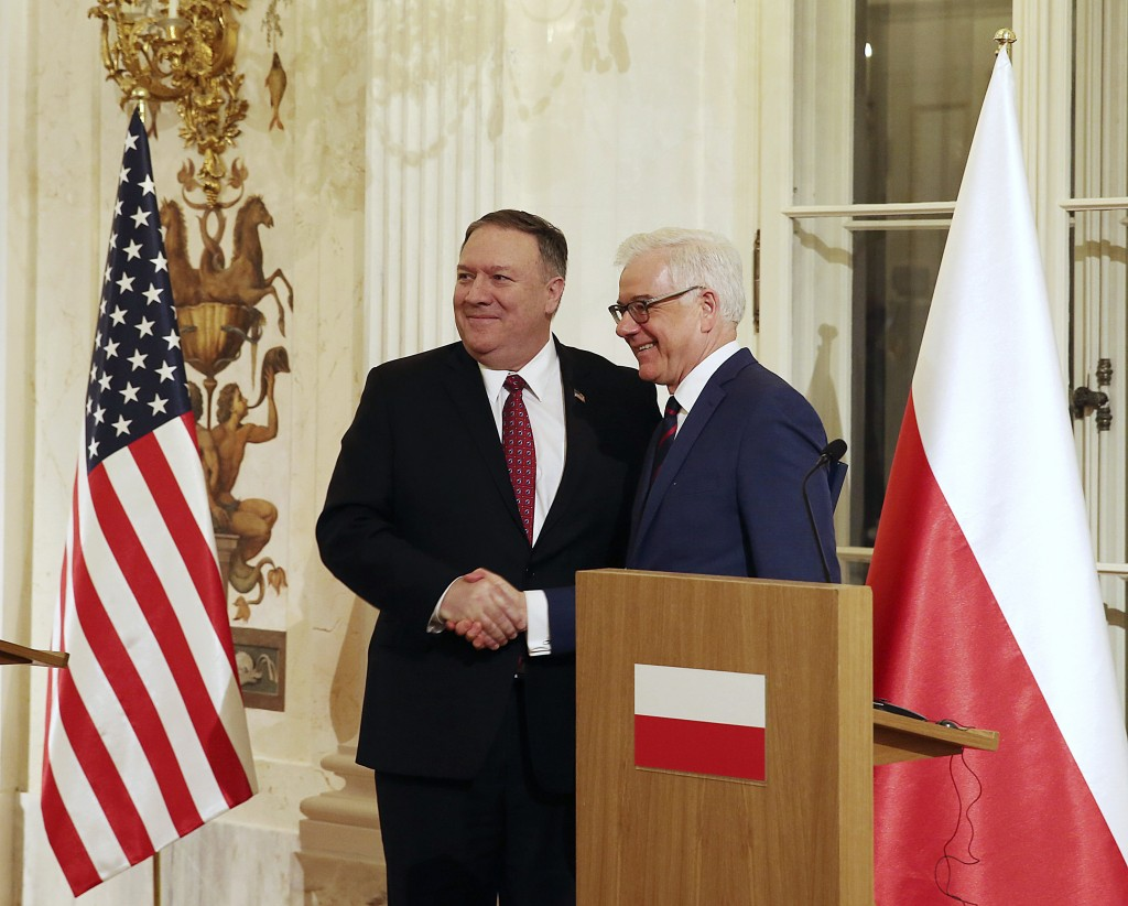 Polish Foreign Affairs Minister Jacek Czaputowicz,right, and US Secretary of State Mike Pompeo shake hands at a news conference at Lazienki Palace, Wa...