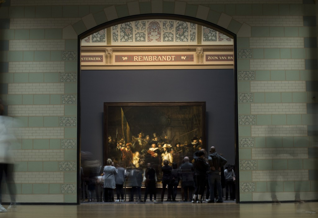 Visitors admire Rembrandt's Night Watch (1642), part of an exhibition of the all the Rijksmuseum's Rembrandt works in Amsterdam, Netherlands, Wednesda...