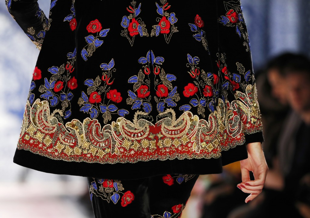 The latest fashion creation from Naeem Khan is modeled during Fashion Week Tuesday, Feb. 12, 2019, in New York. (AP Photo/Kathy Willens)