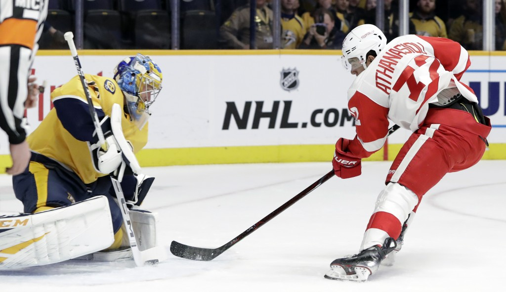 Detroit Red Wings center Andreas Athanasiou (72) shoots against Nashville Predators goaltender Pekka Rinne (35), of Finland, during the first period o...