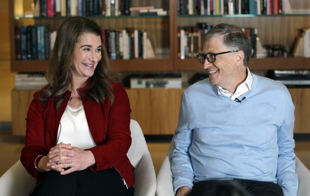 In this Feb. 1, 2019, Bill and Melinda Gates look toward each other and smile while being interviewed in Kirkland, Wash. The couple, whose foundation