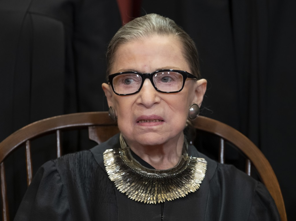 FILE - In this Nov. 30, 2018 file photo, Associate Justice Ruth Bader Ginsburg sits with fellow Supreme Court justices for a group portrait at the Sup...