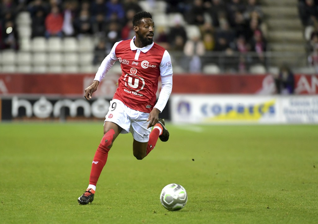 FILE - In this March 9, 2018, file photo, Reims' Anatole Ngamukol controls the ball during a league II soccer match against Chateauroux in Reims, east