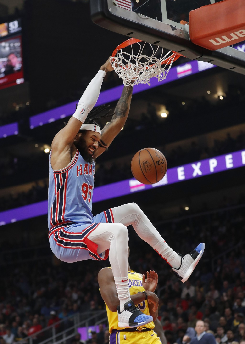 Atlanta Hawks forward DeAndre' Bembry (95) scores against the Los Angeles Lakers during the first half of an NBA basketball game Tuesday, Feb. 12, 201