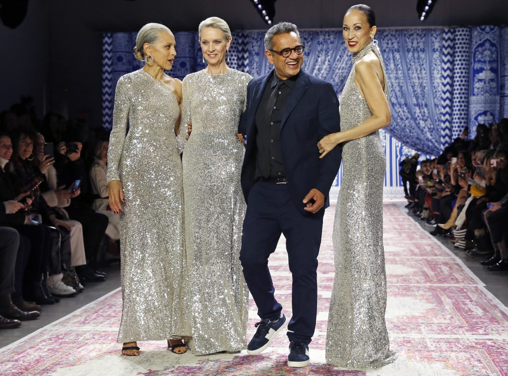 Models Alva Chinn, Karen Bjornson, and Pat Cleveland appear with fashion designer Naeem Khan, after walking the runway during the Naeem Khan show duri