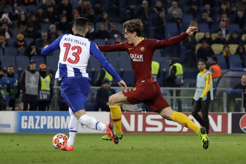 Roma midfielder Nicolo' Zaniolo, right, scores the opening goal of his team during a Champions League round of 16 first leg soccer match between Roma ...