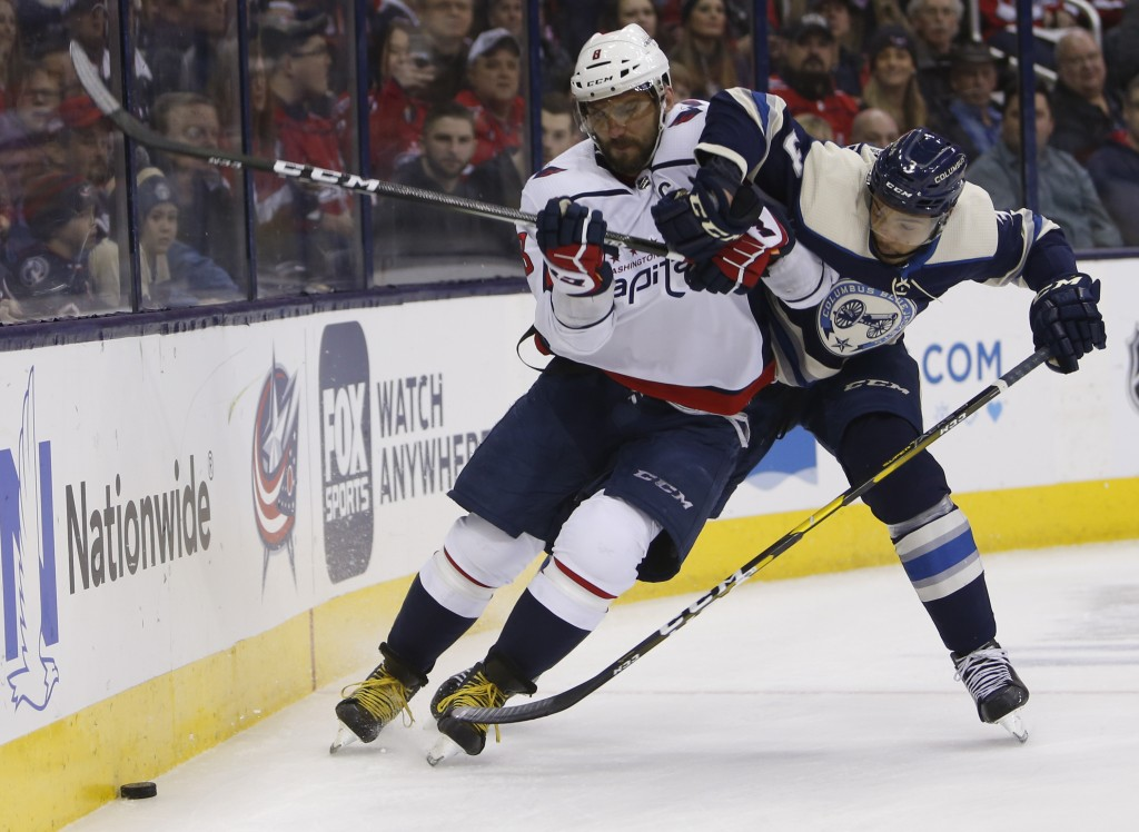 Washington Capitals' Alex Ovechkin, left, of Russia, and Columbus Blue Jackets' Seth Jones chase a loose puck during the first period of an NHL hockey