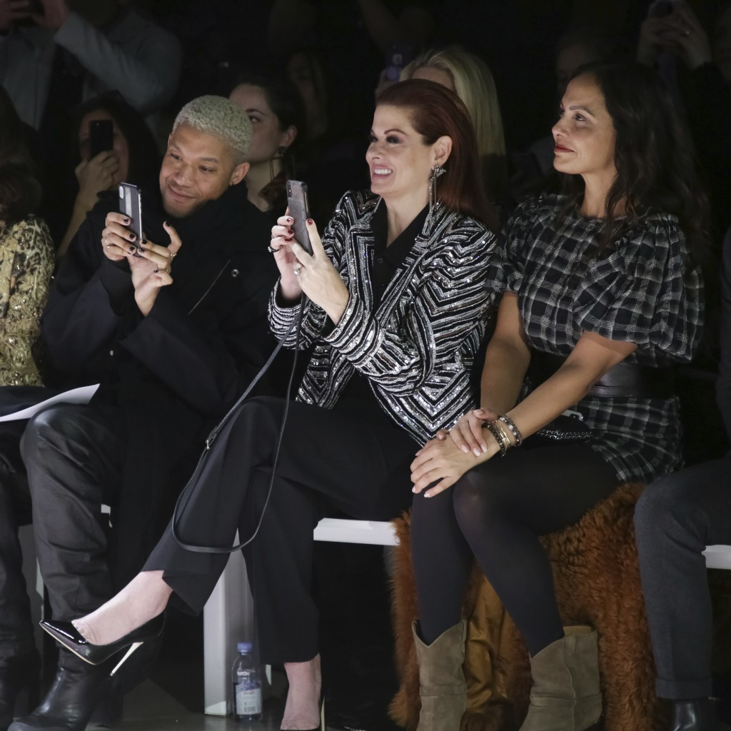 Debra Messing, center, attends the Naeem Khan Runway Show at Spring Studios during New York Fashion Week on Tuesday, Feb. 12, 2019 in New York. (Photo...