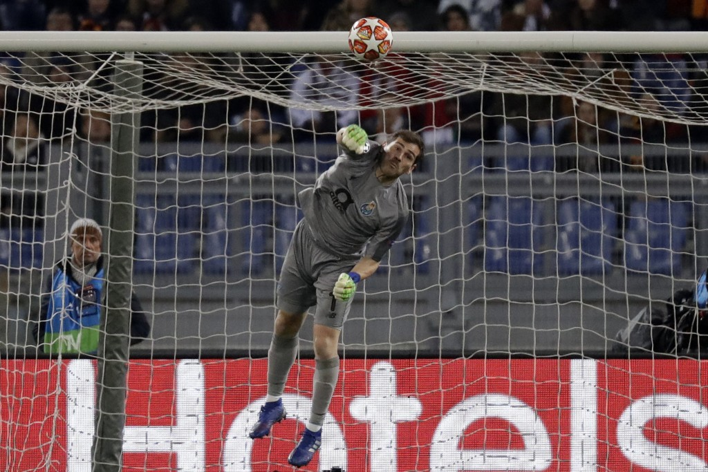 Porto goalkeeper Iker Casillas saves a ball during a Champions League round of 16 first leg soccer match between Roma and Porto, at Rome's Olympic Sta...