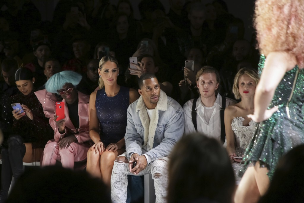 Carmen Carrera, from left, Victor Cruz, Barron Hilton II and Tessa Hilton attend The Blonds Runway Show held at Spring Studios during New York Fashion