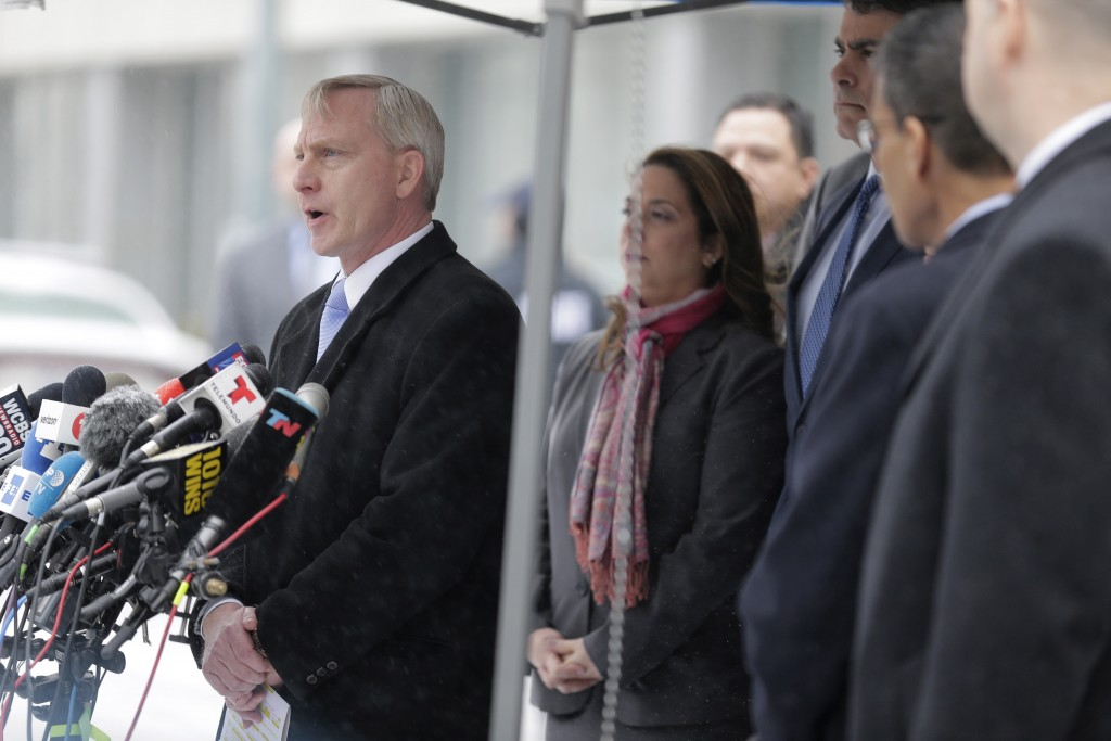 Richard Donoghue, U.S. Attorney for the Eastern District of New York, speaks to reporters after leaving the federal courthouse in New York, Tuesday, F...