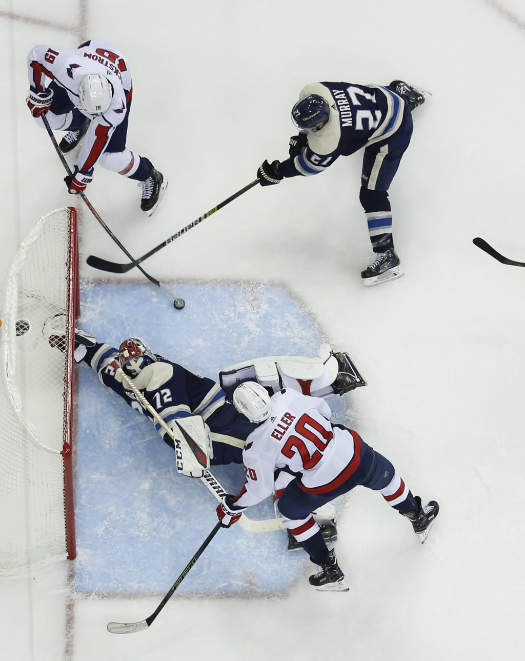 Columbus Blue Jackets' Sergei Bobrovsky (72), of Russia, makes a save as teammate Ryan Murray, top right, tries to clear the puck away from Washington