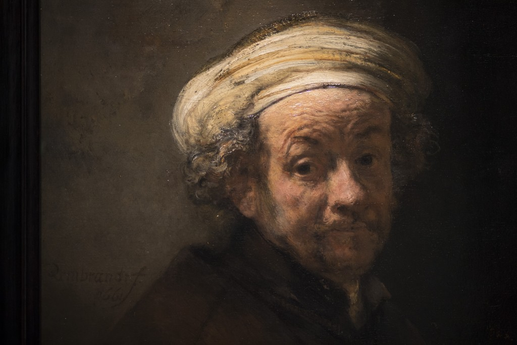 """Detail of Rembrandt's """"Self-portrait as the Apostle Paul"""" (oil on canvas, 1661) with his signature seen left, close to the frame, during a press previ..."""
